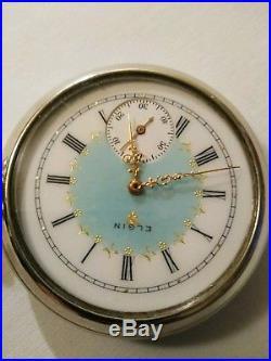 Elgin 16S. 17J. Adj. Mint fancy dial 3 f. B. Gold trimmed movement display case